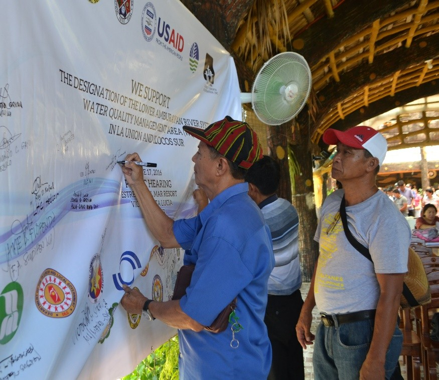 Indigenous People representatives signing the covenant of support for the designation of the Upper Amburayan River as a Water Quality Management Area.